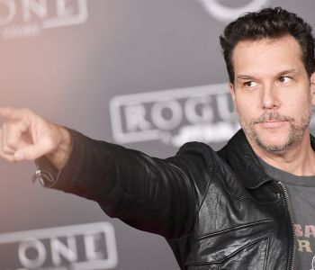 Dane Cook Holding A Sign Posing For The Camera